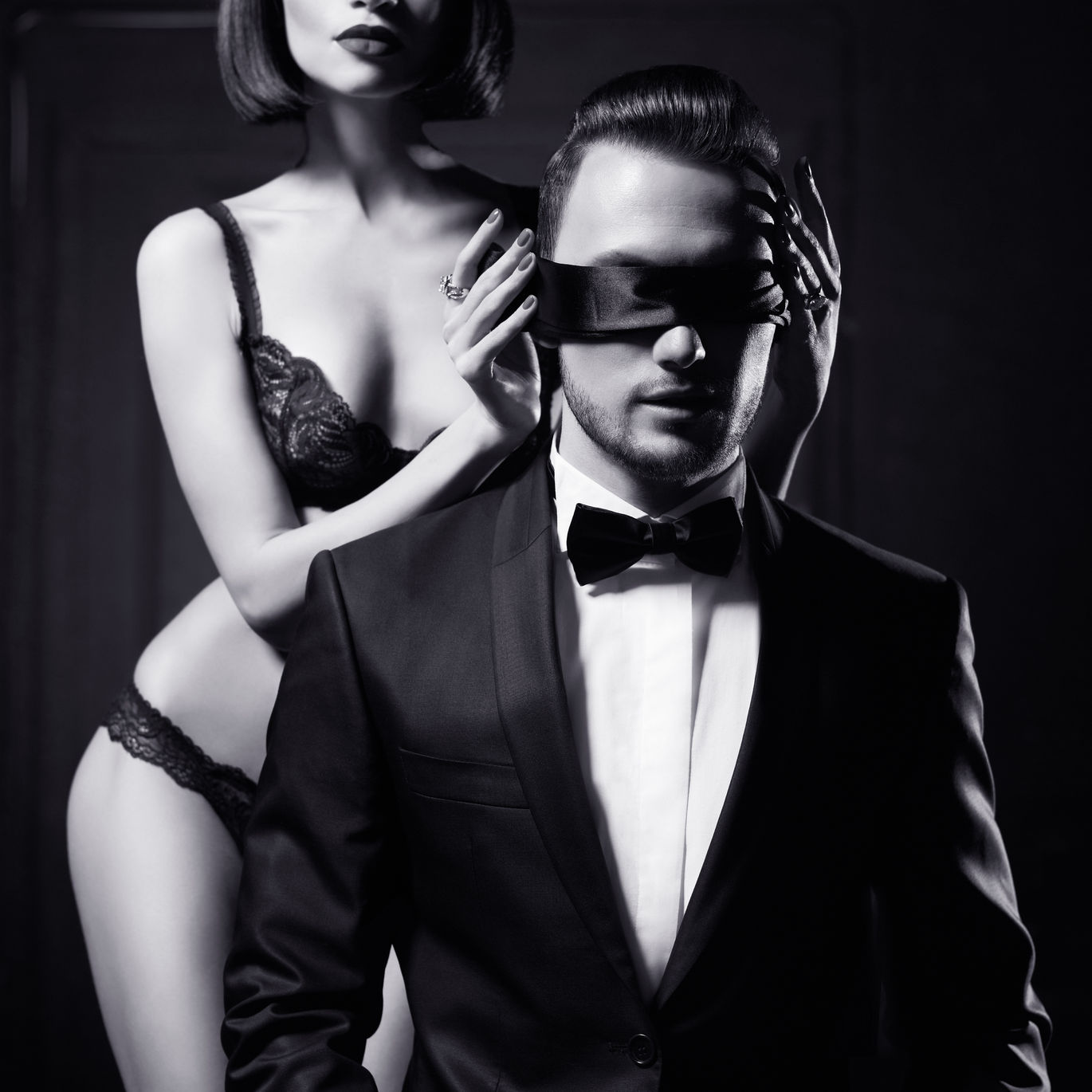 40322499 – fashion studio photo of a sensual couple in lingerie and a tuxedo